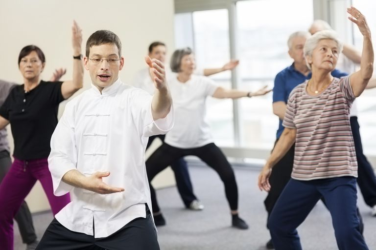 Adults Doing Tai Chi Exercises