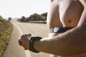 Runner Checking Heart Rate Monitor