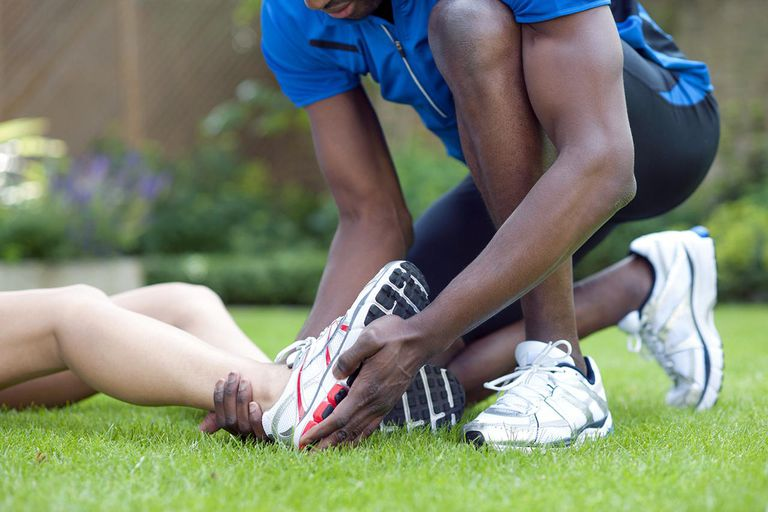 Ankle injury. Female runner with an ankle injury.