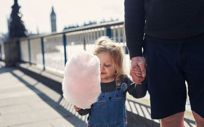 little girl holding cotton candy
