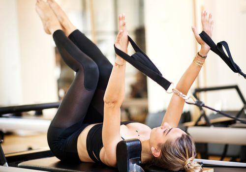 Woman doing Pilates on reformer