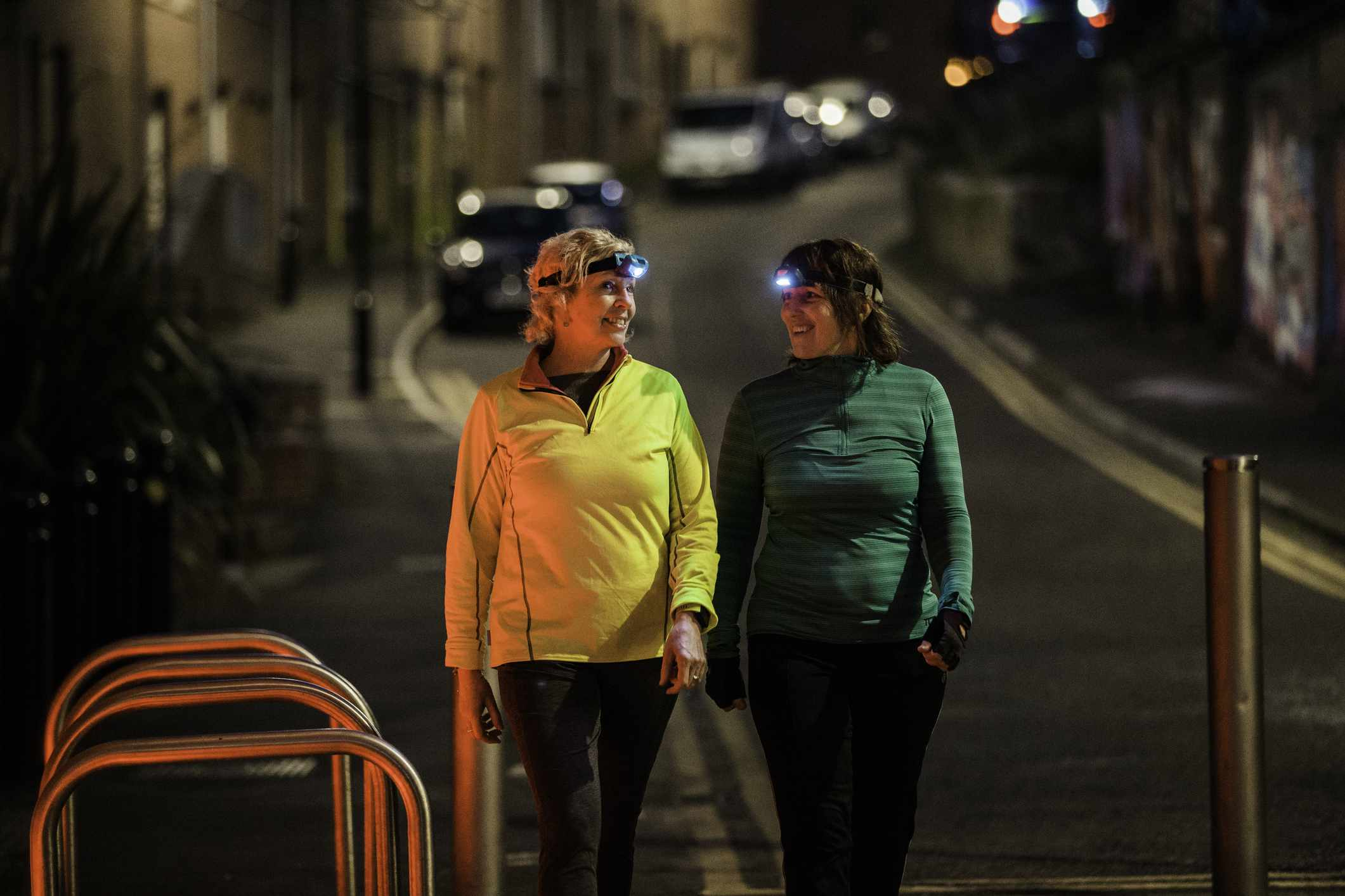 Two Friends Walking Together At Night