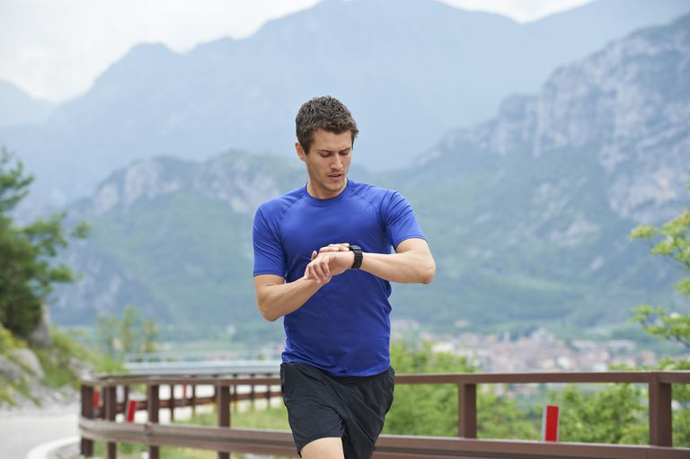 runner looking at watch