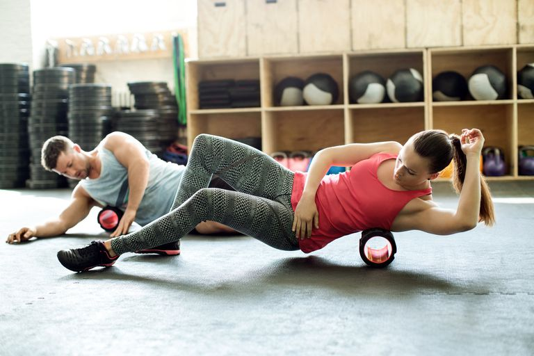 People in gym using support roller