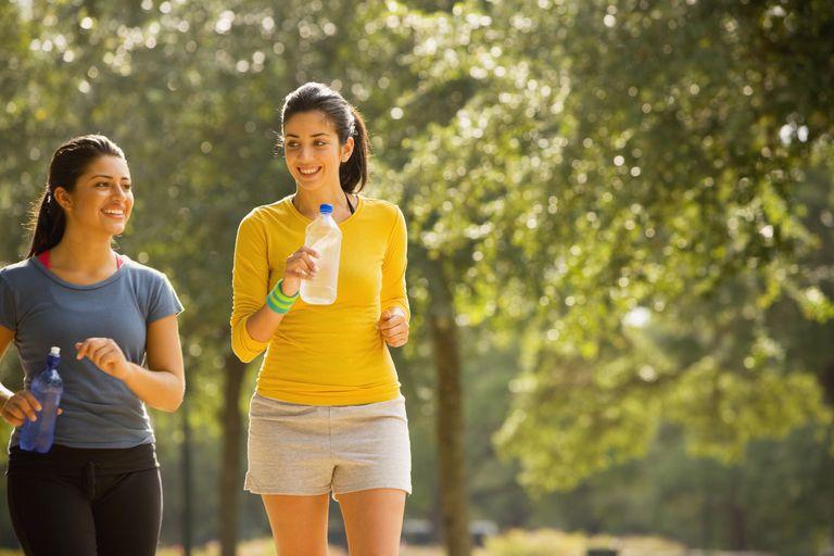 Women walking outside with water bottles in hand