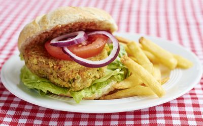 veggie burger and fries on a plate