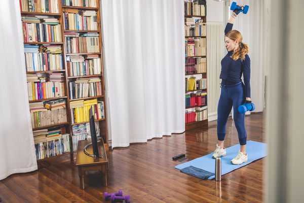 Older woman lifting weights at home