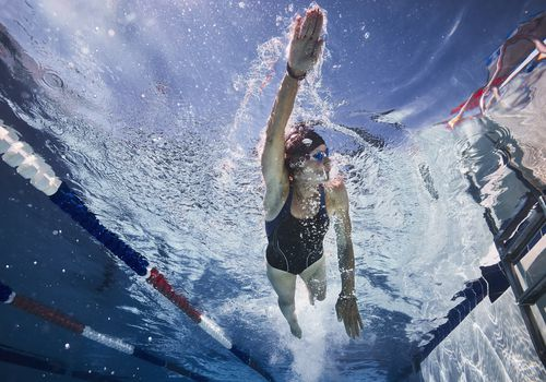woman doing a swimming workout in the pool