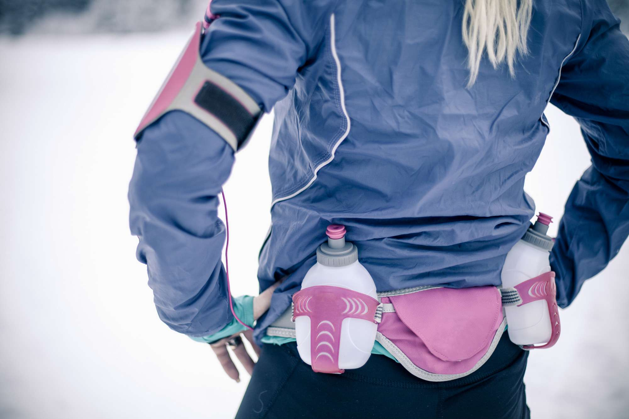 woman wearing a hip belt with water bottles