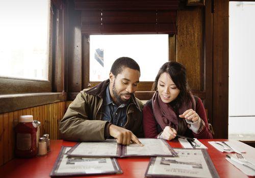 Couple looking at a restaurant menu