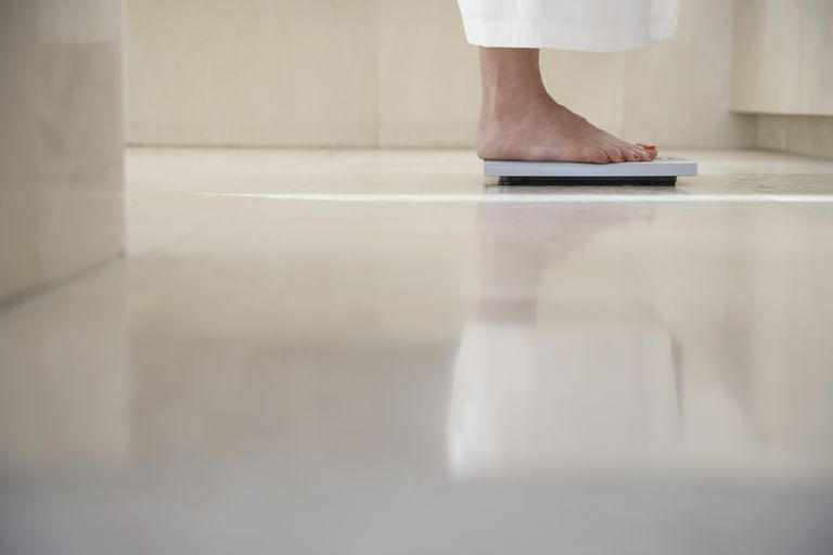 closeup of feet on a scale