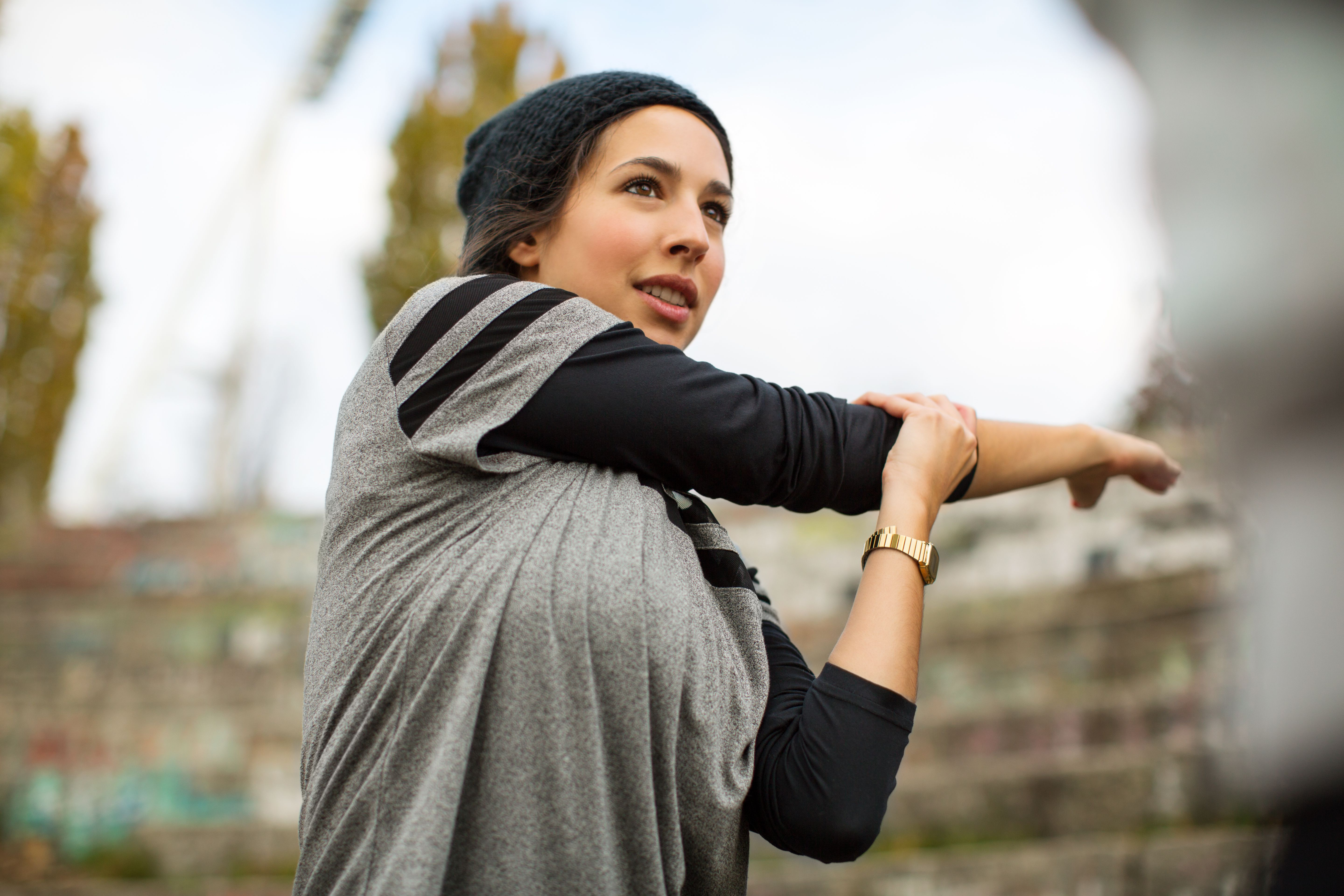 Woman stretching arms before exercise