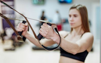 Woman with TRX bands
