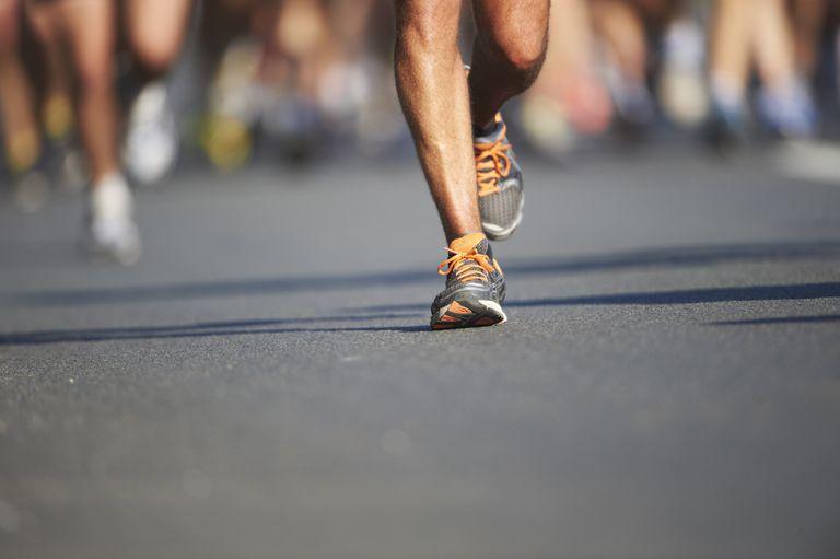 Legs and feet of joggers, running a marathon