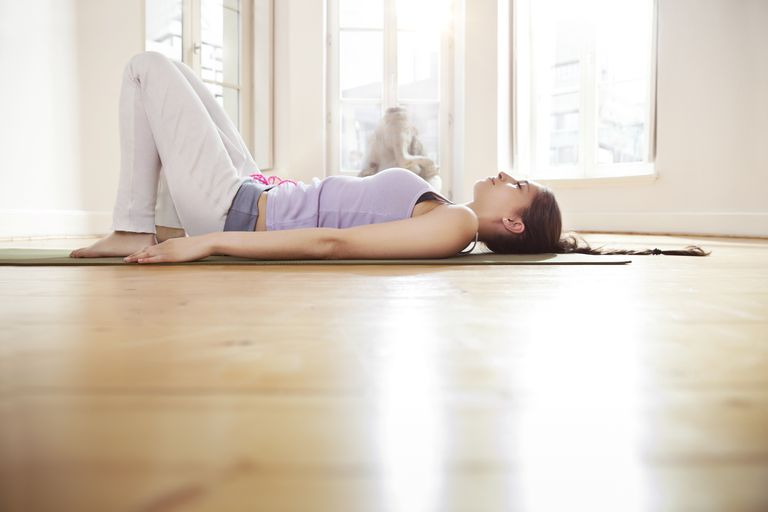 Woman laying on a yoga mat