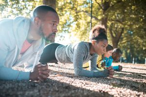 group doing the plank exercise outside