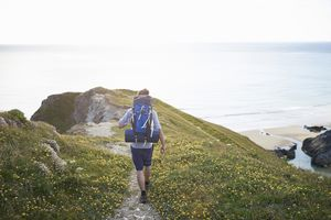 Hiker walking along coastal path