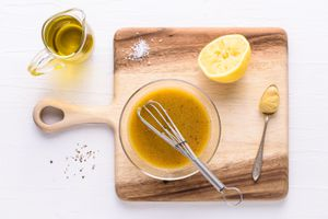 salad dressing recipe with oil, spices, lemon, and mustard
