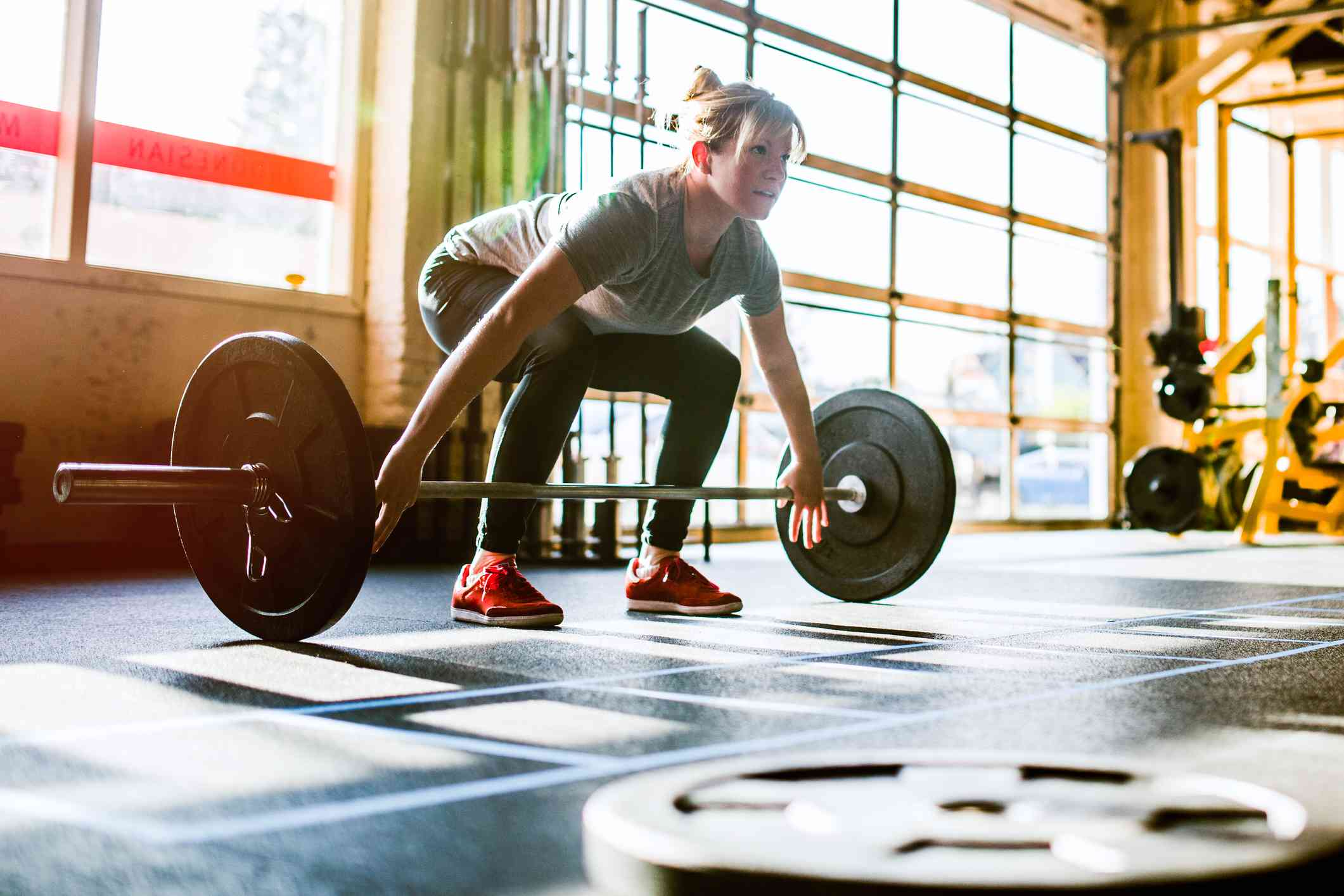 Lower Body Circuit Blast To Tone Your Legs Chest And Back Superset Workout Tighten Cross Training Woman Performing Deadlift A Young Exhibits Her Strength Power Ability