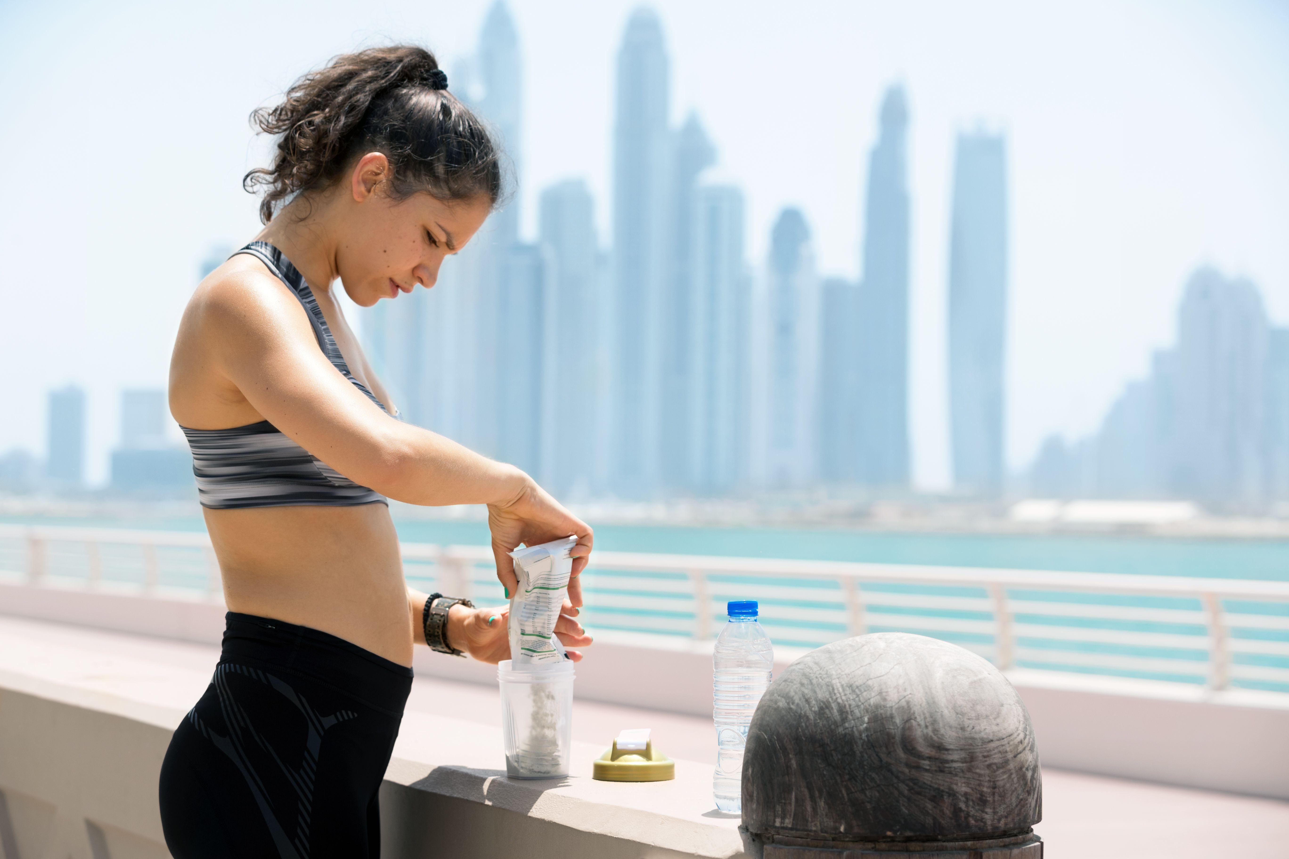 Female runner preparing refreshment