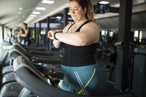 Woman tracking calorie burn on treadmill