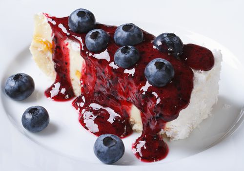 berry sauce and blueberries on cheesecake
