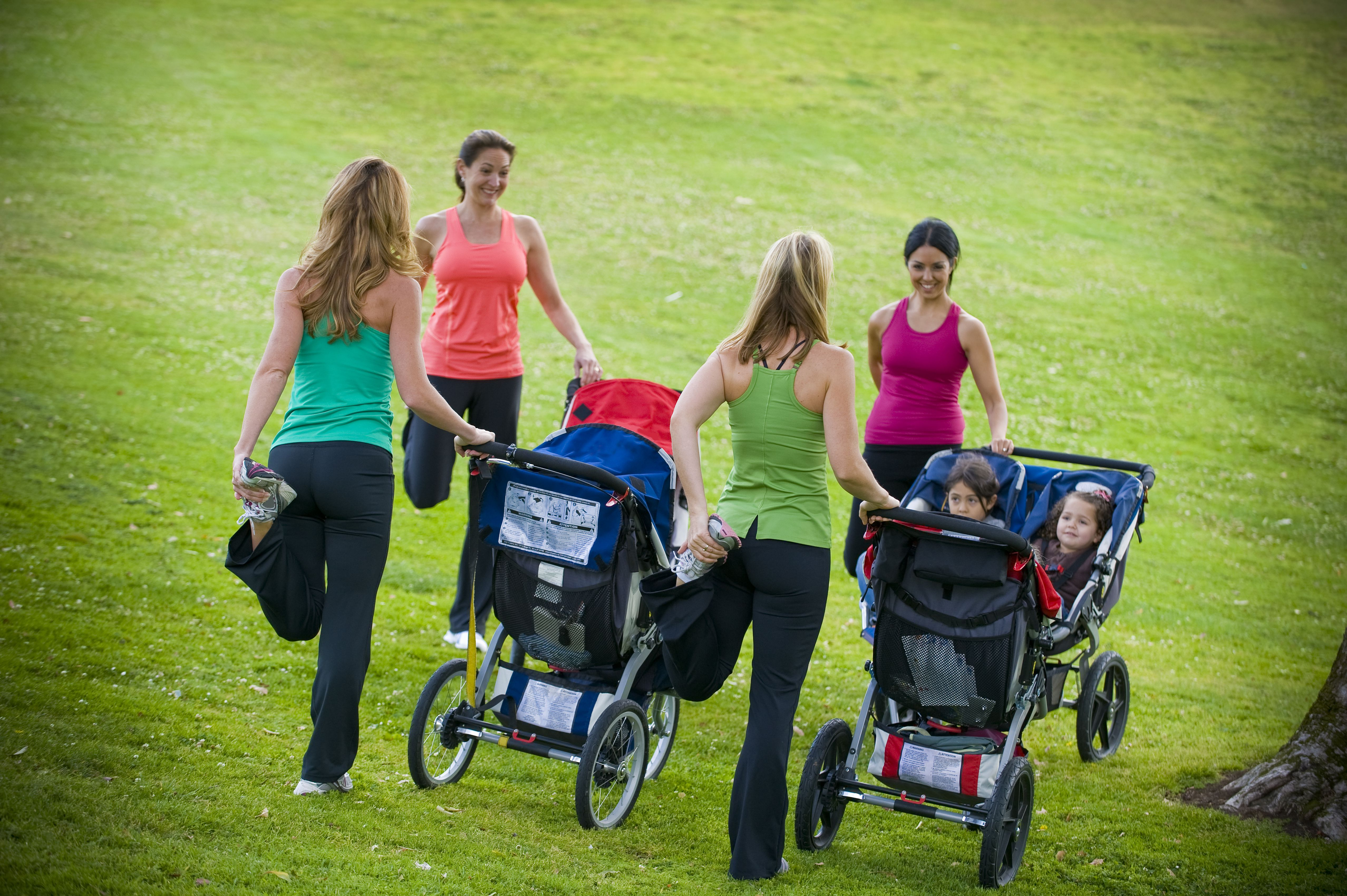 moms with strollers stretching