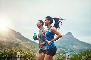 Shot of a young attractive couple training for a marathon outdoors