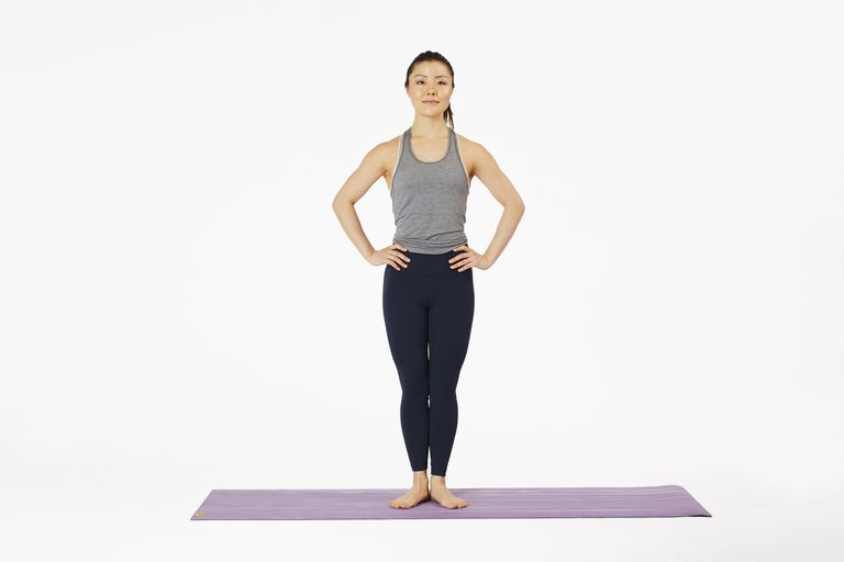 Woman standing on yoga mat in Pilates stance