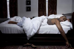 Man sleeping in bed.