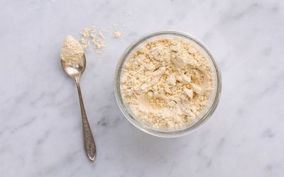 powdered peanut butter in bowl with spoon