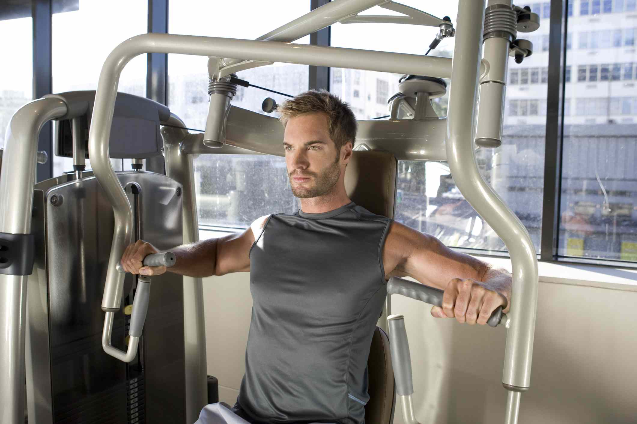man doing seated chest press