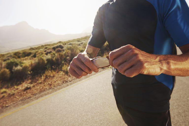 runner eating sports gel