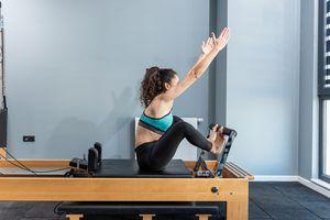 Woman exercising on Pilates reformer