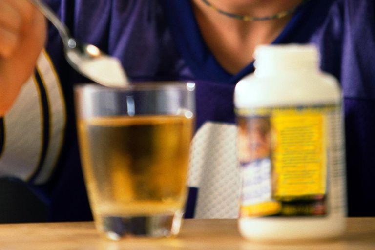 Natural Bodybuilding Supplements -- glutamine in glass of liquid