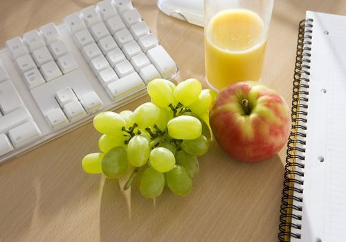 fruit and juice on a desk