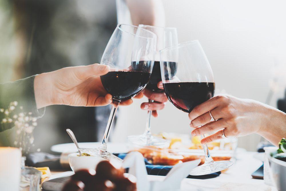 Three wine glasses clinking