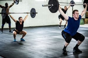 gym - class doing overhead squats