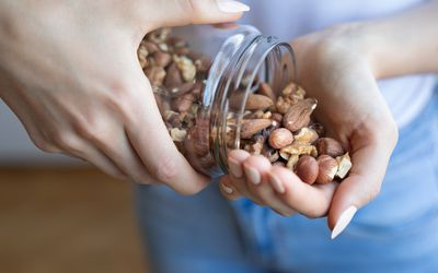 woman pouring nuts out of a jar