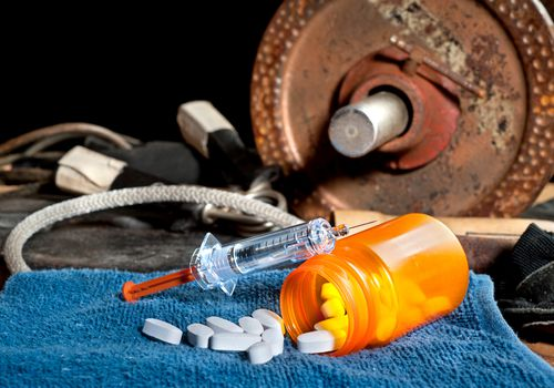 Barbell, pills and syringe