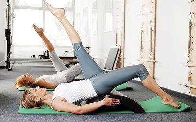 Two women doing pilates on mats