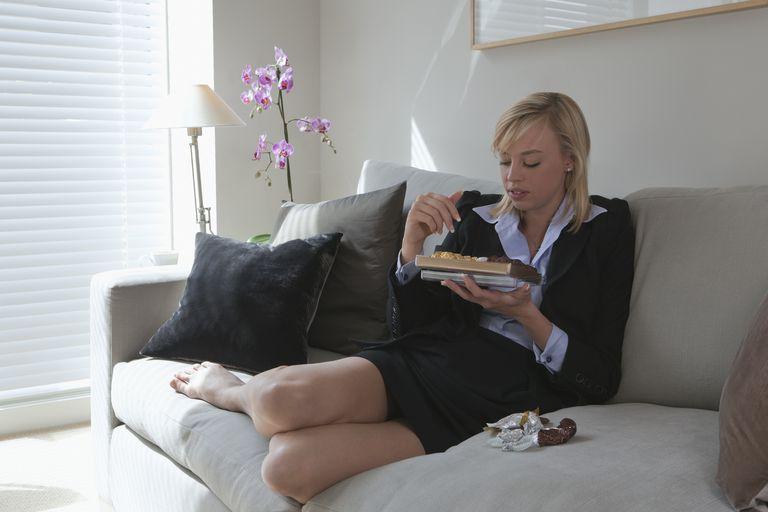 Woman eats chocolates