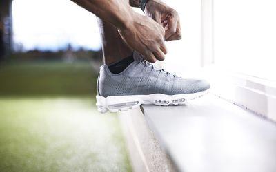 man tying his sneaker