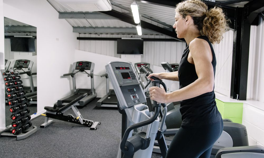 Woman on an elliptical trainer