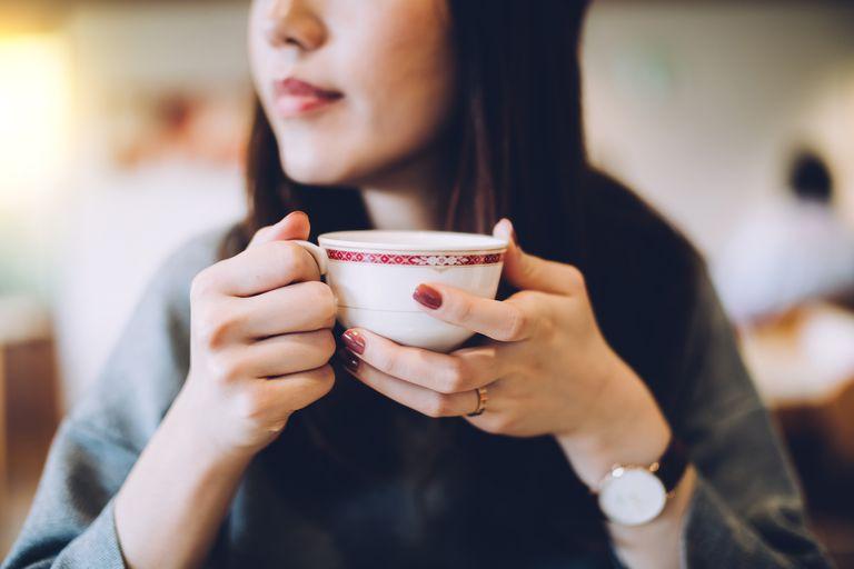 Smiling woman enjoying tea