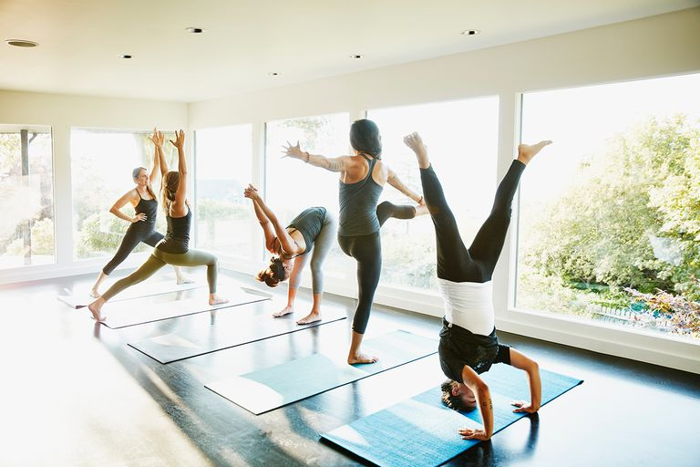 Group of women warming up before yoga class