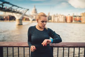 Woman checking heart rate watch