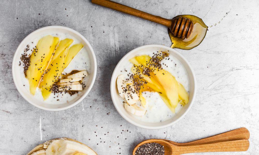 Greek yogurt bowls with mango, banana, chia seeds, and honey