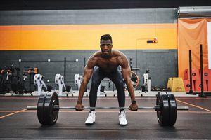 Man weightlifting at gym