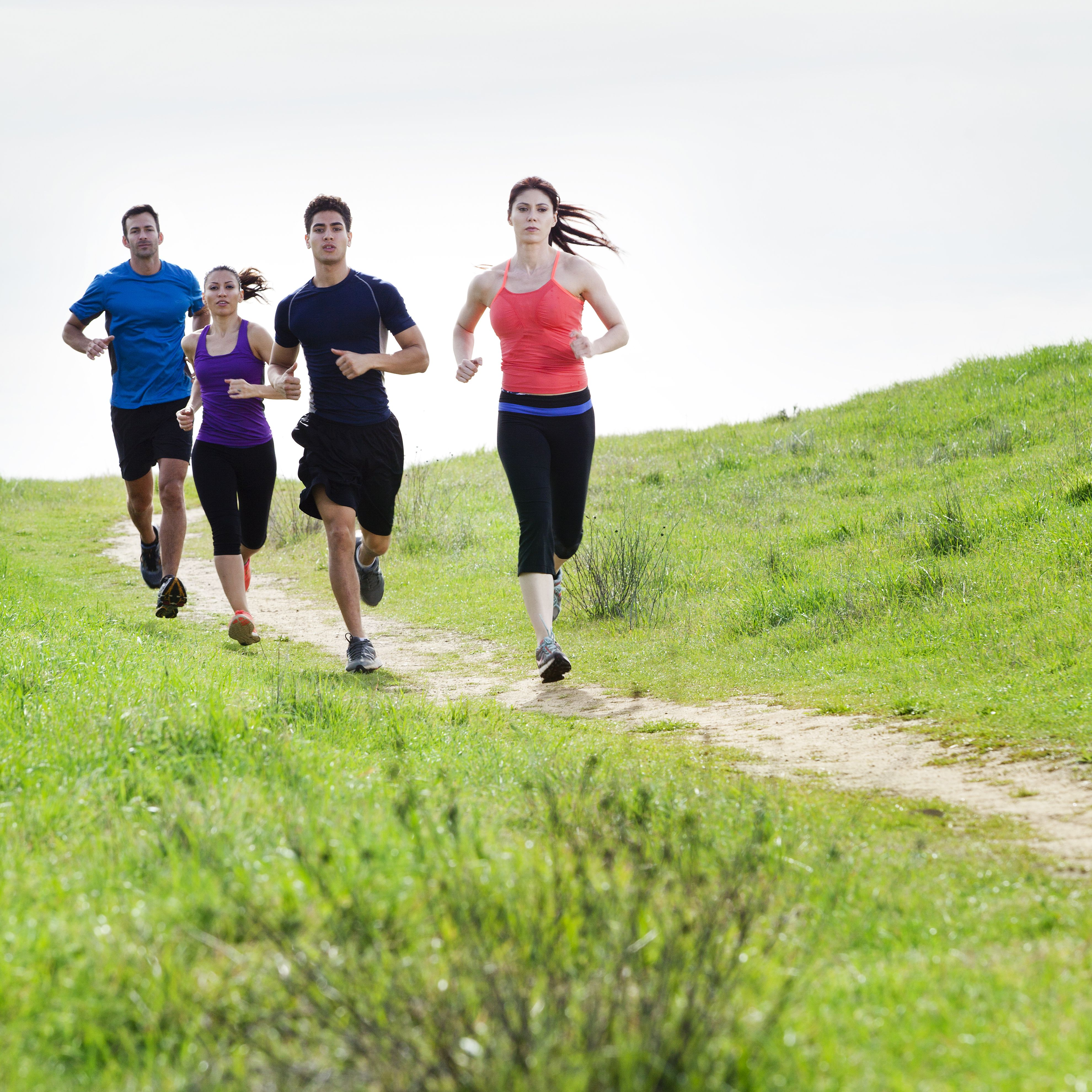 Runners on a dirt trail